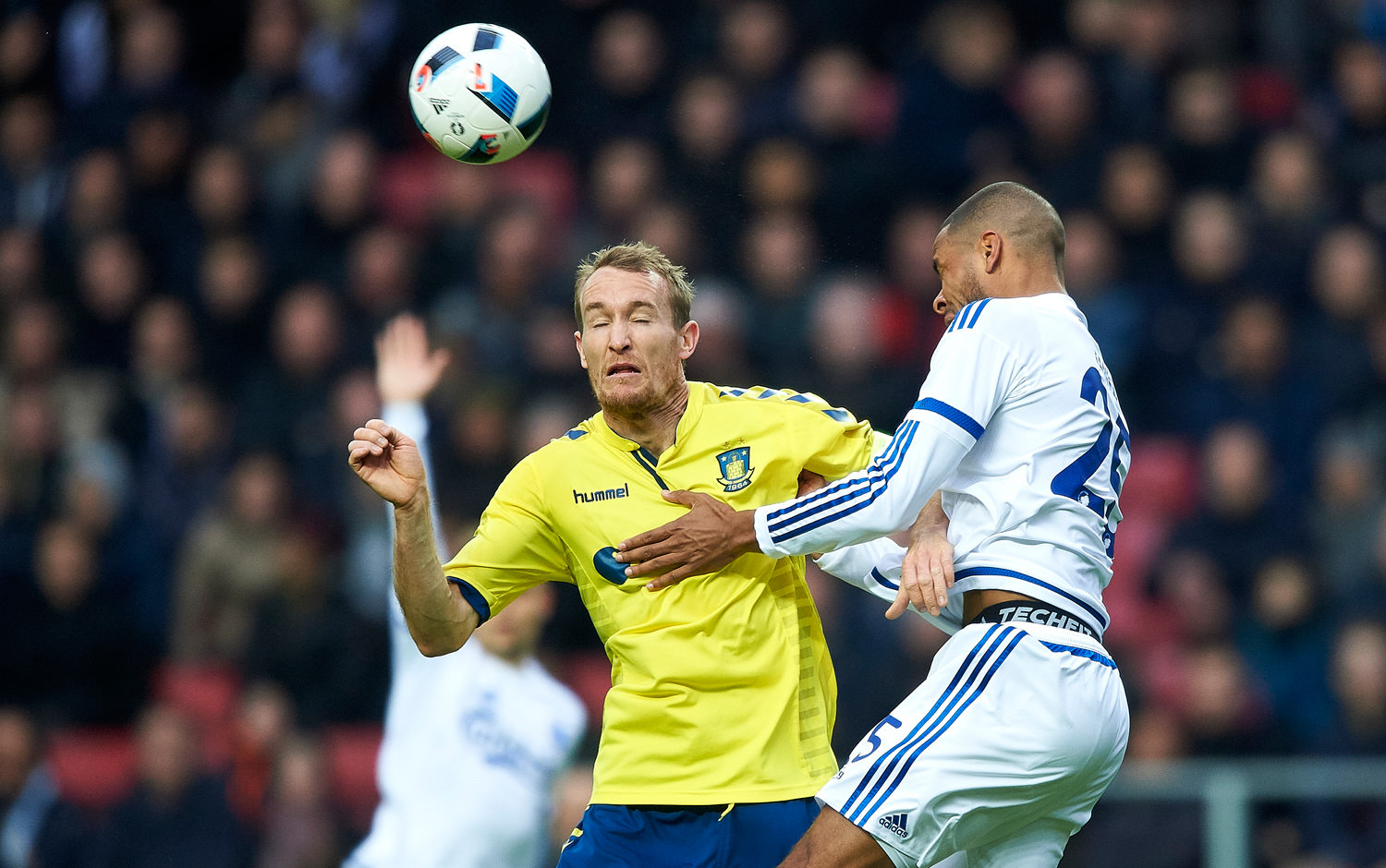 COPENHAGEN, DENMARK - APRIL 17: Thomas Kahlenberg of Brondby IF and Mathias Zanka Jorgensen of FC Copenhagen compete for the ball during the Danish Alka Superliga match between FC Copenhagen and Brondby IF at Telia Parken Stadium on April 17, 2016 in Copenhagen, Denmark. (Photo by Lars Ronbog / FrontZoneSport via Getty Images)