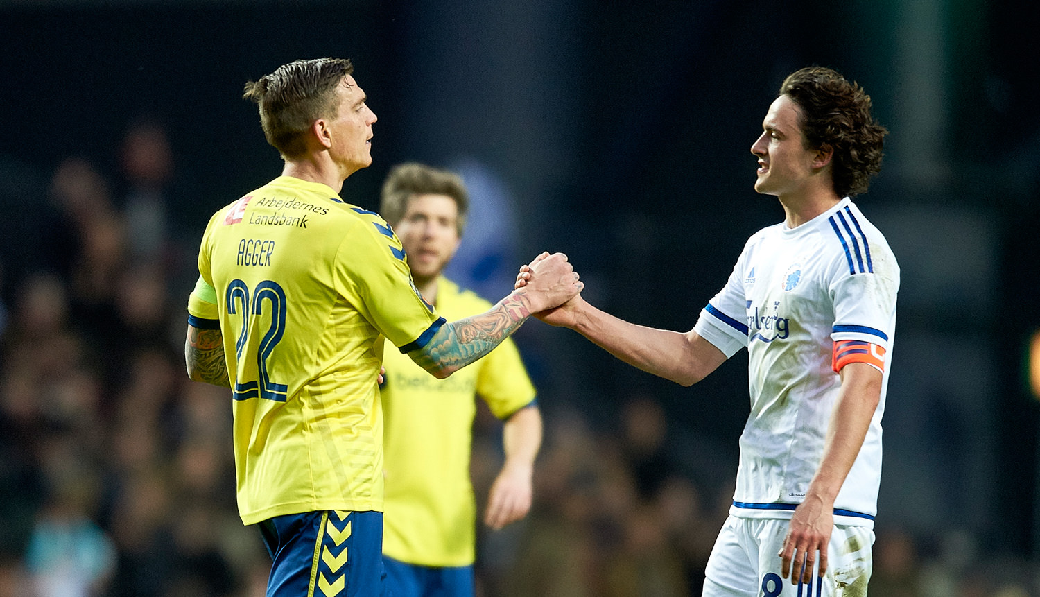COPENHAGEN, DENMARK - APRIL 17: Daniel Agger of Brondby IF and Thomas Delaney of FC Copenhagen shake hands after the Danish Alka Superliga match between FC Copenhagen and Brondby IF at Telia Parken Stadium on April 17, 2016 in Copenhagen, Denmark. (Photo by Lars Ronbog / FrontZoneSport via Getty Images)